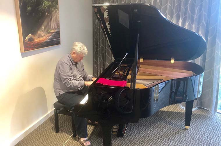 Roy playing the piano