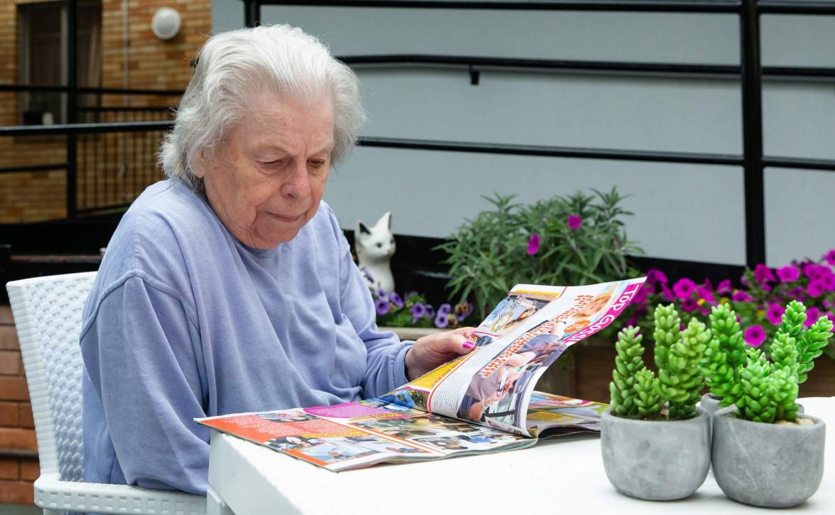 Annandale Grove resident at table reading